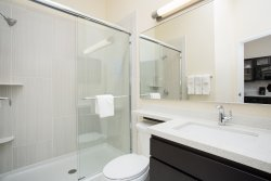 Candlewood Suite Longmont bathrooms feature either a shower or a combination bathtub/shower