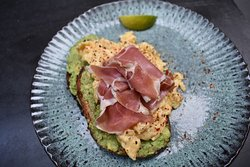 Prosciutto and scambled eggs on toast