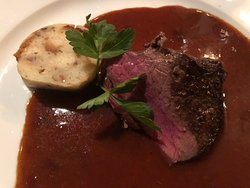 Grilled deer saddle with rose hip sauce and Carisbad dumplings