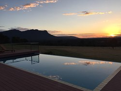 Nice view of the pool and grounds at sunset which is right next to the dining room