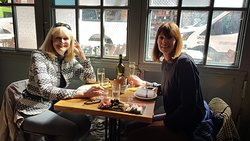 Me and my friend having lunch! Great seat looking into the street!