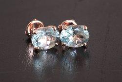 Natural aquamarine gemstones from Takeo province, Cambodia, set in rose gold.
