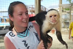 My niece interacting with a monkey.