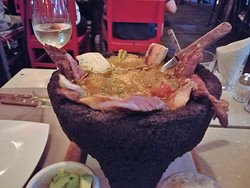 A lava bowl - Molcajetes of fresh fish, chicken and steak.
