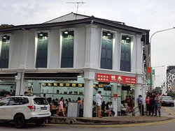 People queuing outside the restaurant.