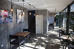 Zarah's airy interior space with concrete, wood and steel elements