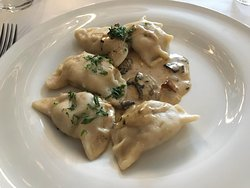Dumplings stuffed with meat with a mushroom sauce
