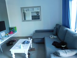 Lounge with mirror, TV and casual seating area