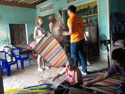 Visiting a private home and learning how to make sleeping mats.