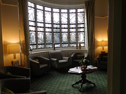 The beautiful Italian bay window which looks out on Kensington Gardens from our main bar area