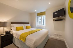 Relax in your separate double bedroom in our one bedroom apartments with a weekly linen change.