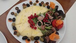 Cheese with anchovies and olives