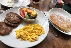 My scrambled egg, sausage, fruit and two pancake breakfast