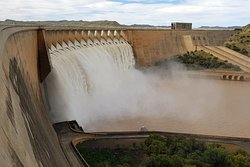 Dam full, water overflowing