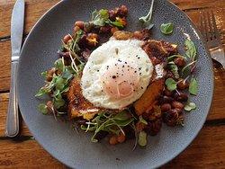 From our Breakfast Menu: House beans, golden polenta cakes, fried egg (V, GF)