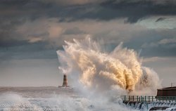 Waves crashing over the pier
