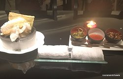 Meal begins with a hot towel, crackers and delicious sauces