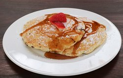 Yummy fluffy pancakes with syrup and strawberries anyone?