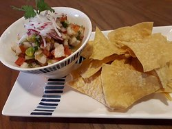 Our new dish Sea bass Ceviche with our homemade corn tortillas chips