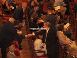 Bolshoi director Urin shaking hands with a colleague