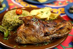 Pigeon stuffed with green wheat and herbs