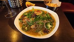 A quality burger place also offers refeshing Pho with a lot of limes and herbs!
