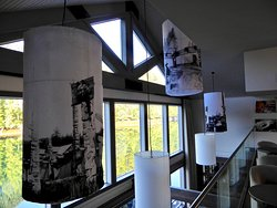 Historic photos of Haida villages adorn lampshades over dining room
