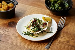 Atlantic scallops cooked over charcoal in garlic butter and chorizo, topped with samphire.