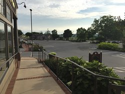 the empty parking lot view from my rocking chair outside the Quilt Store in the evening