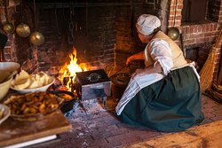 Hearth cooking demonstration, usually offered in the Fall