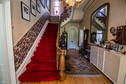 Walking through the front entrance you are greeted with the grand staircase.