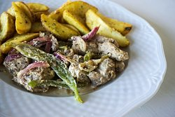 Pork Tigania: our special plate made with Charma Dunkel beer.. (by G. Petrakis)