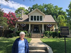 Mom in front of the house