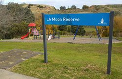Reserve sign with playground behind