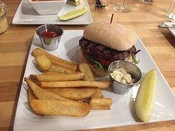 a burger on ciabatta roll with dijon aioli sauce