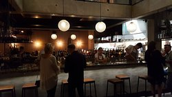The industrial-chic vibe of the bar