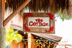 ‪The Cottage‬