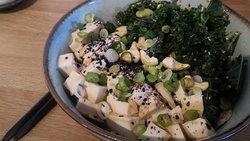 Tofu poké. Shoyu marinade tofu, kale and edamame beans salad, ponzu dressing, on top of sushi ri