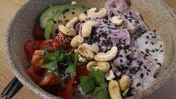 Tuna poké. Coconut & Lime marinade, avocado, tomato, pepper, coriander salad on top of sushi ric