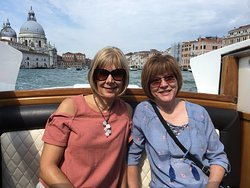 Enjoying our complimentary water taxi ride to Murano.