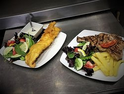 Beer battered haddock (Fridays only booking req) Pork chops with a honey mustard sauce