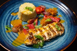 Skin-on chicken breast, mint couscous, yellow curry sauce