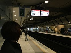 Sydney airport train station. Take T8 and get off at Circular Quay. No transfer.