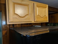 Upside down cabinets and dusty fridge