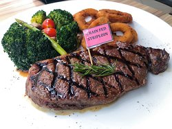 Juicy and tender grain fed striploin served with sautéed vegetables and crispy onion rings.