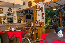 view inside restaurant towards bar & pool/garden