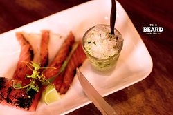 Salmon Gravlax. Not just ice, but frozen gin tonic with cucumber shaving.