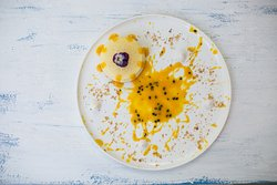 New York Cheesecake with Mango Puree and Passion Fruit