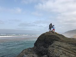 If you're staying in Cannon Beach, it's an easy 15 minute drive south to beautiful Hug Point. Caves, a mini waterfall, and tidal pools to explore at low tide make this a unique beach to the area.