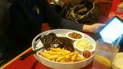 Smoked ribs with BBQ baked beans, slaw, french fries, and Texas toast
